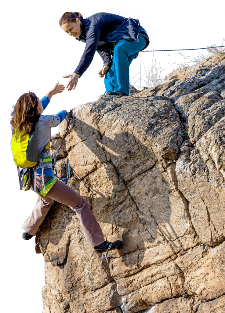 Rock climbers assisting each other